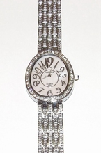 Horloge ovale zachtroze wijzerplaat met strass steentjes