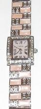 Horloge met oudroze steentjes en heldere strass